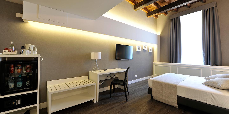 hotel-maxxim-finitute-liuni-design-pavimenti-tende