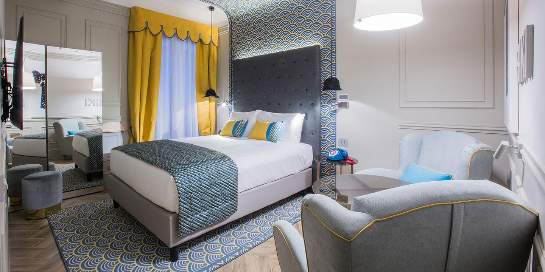 liuni_hotel_indigo_monforte_tessuti_runner_tendaggi_tappetto_cuscino_baldacchino